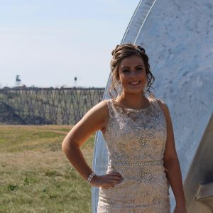Woman in a dress in front of the high level bridge in Lethbridge